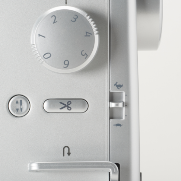 Juki TL2020 detailed image of speed dial and thread buttons